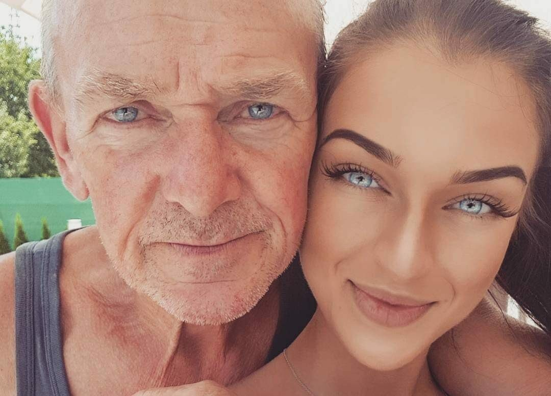 grandfather and granddaughter share a very similar tone of sky blue eyes